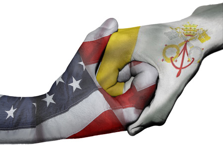 Diplomatic handshake between countries: flags of United States and Vatican City overprinted the two hands