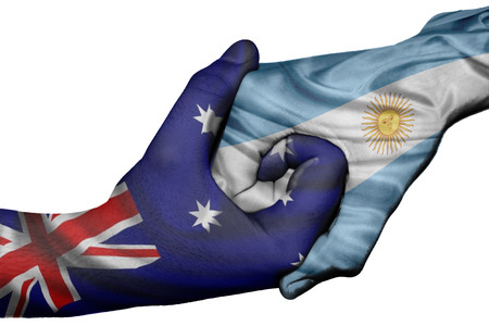 Diplomatic handshake between countries: flags of Australia and Argentina overprinted the two hands