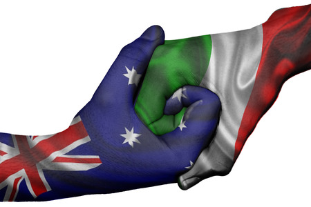 Diplomatic handshake between countries: flags of Australia and Italy overprinted the two hands photo