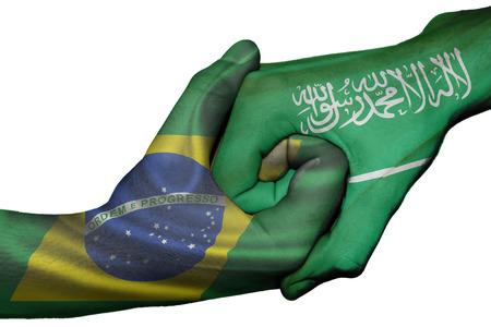 diplomatic: Diplomatic handshake between countries: flags of Brazil and Saudi Arabia overprinted the two hands