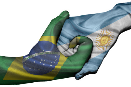 Diplomatic handshake between countries: flags of Brazil and Argentina overprinted the two hands