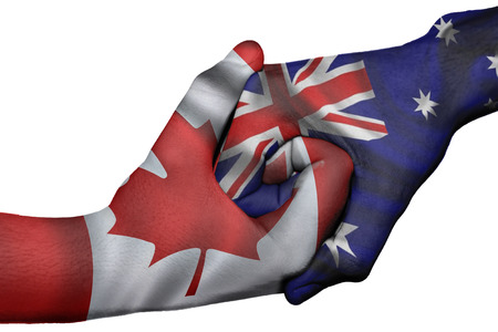 Diplomatic handshake between countries: flags of Canada and Australia overprinted the two hands Stock Photo