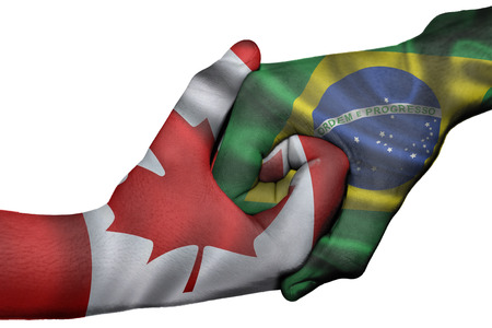 Diplomatic handshake between countries: flags of Canada and Brazil overprinted the two hands photo