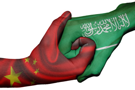diplomatic: Diplomatic handshake between countries: flags of China and Saudi Arabia overprinted the two hands