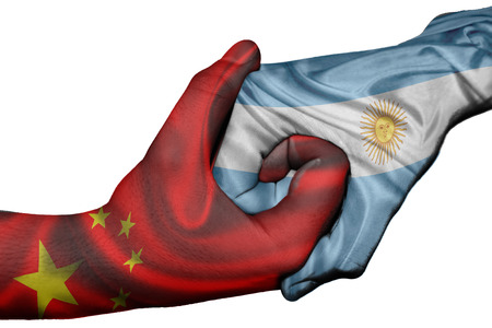 Diplomatic handshake between countries: flags of China and Argentina overprinted the two hands photo