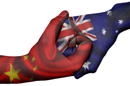 Diplomatic handshake between countries: flags of China and Australia overprinted the two hands Stock Photo