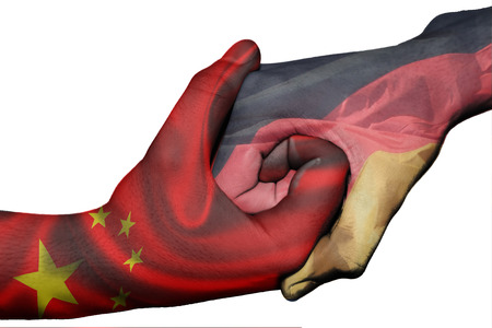 Diplomatic handshake between countries: flags of China and Germany overprinted the two hands photo