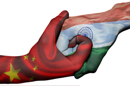 Diplomatic handshake between countries: flags of China and India overprinted the two hands photo
