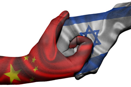 Diplomatic handshake between countries: flags of China and Israel overprinted the two hands Stock Photo