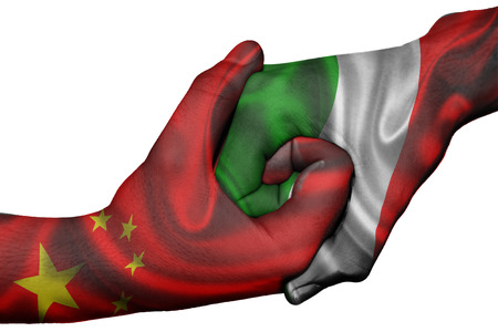 diplomatic: Diplomatic handshake between countries: flags of China and Italy overprinted the two hands