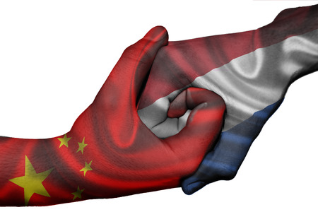 Diplomatic handshake between countries: flags of China and Netherlands overprinted the two hands photo
