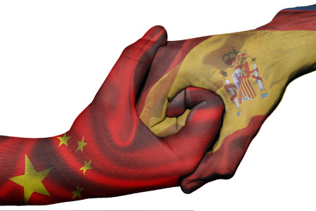 diplomatic: Diplomatic handshake between countries: flags of China and Spain overprinted the two hands