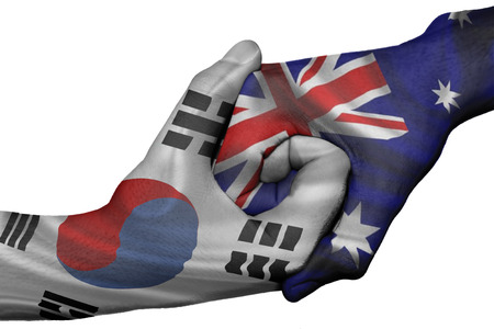 Diplomatic handshake between countries: flags of South Korea and Australia overprinted the two hands
