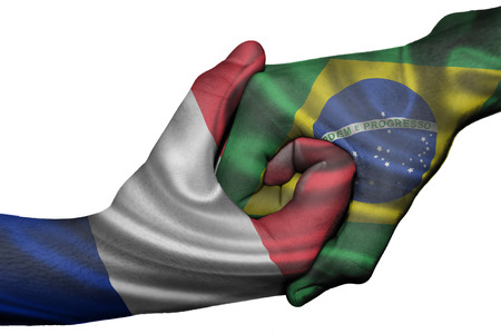 Diplomatic handshake between countries: flags of France and Brazil overprinted the two hands