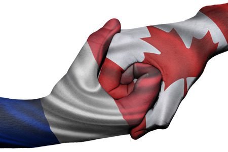 Diplomatic handshake between countries: flags of France and Canada overprinted the two hands photo