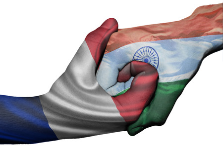 Diplomatic handshake between countries: flags of France and India overprinted the two hands photo