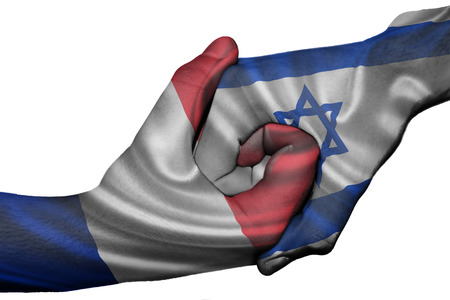 Diplomatic handshake between countries: flags of France and Israel overprinted the two hands photo