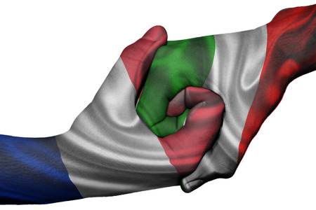 Diplomatic handshake between countries: flags of France and Italy overprinted the two hands