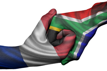 Diplomatic handshake between countries: flags of France and South Africa overprinted the two hands photo