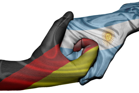 Diplomatic handshake between countries: flags of Germany and Argentina overprinted the two hands photo