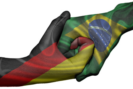 Diplomatic handshake between countries: flags of Germany and Brazil overprinted the two hands photo