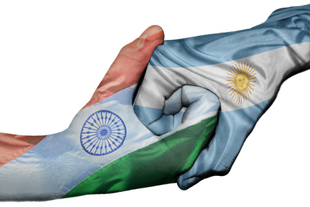 asian business meeting: Diplomatic handshake between countries: flags of India and Argentina overprinted the two hands
