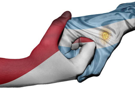 diplomatic: Diplomatic handshake between countries: flags of Indonesia and Argentina overprinted the two hands