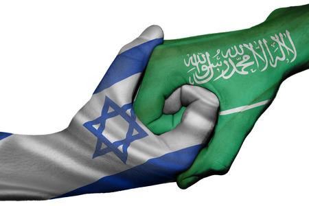 diplomatic: Diplomatic handshake between countries: flags of Israel and Saudi Arabia overprinted the two hands