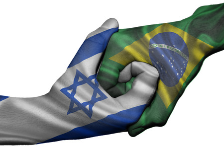 Diplomatic handshake between countries: flags of Israel and Brazil overprinted the two hands photo