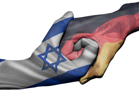 Diplomatic handshake between countries: flags of Israel and Germany overprinted the two hands photo