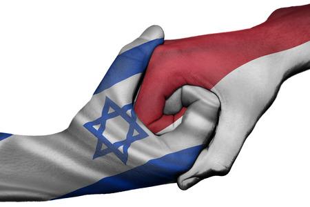 israel people: Diplomatic handshake between countries: flags of Israel and Indonesia overprinted the two hands
