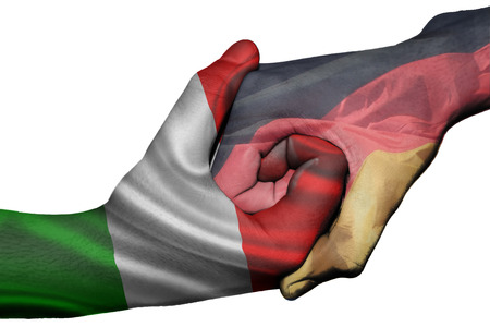 Diplomatic handshake between countries: flags of Italy and Germany overprinted the two hands photo