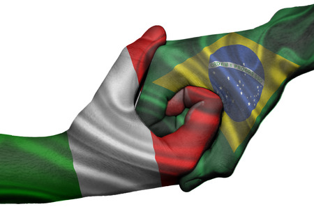 Diplomatic handshake between countries: flags of Italy and Brazil overprinted the two hands photo