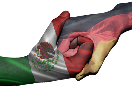 Diplomatic handshake between countries: flags of Mexico and Germany overprinted the two hands