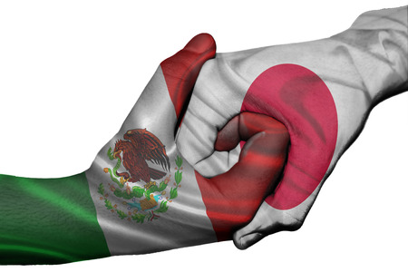 Diplomatic handshake between countries: flags of Mexico and Japan overprinted the two hands