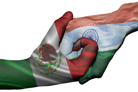 diplomatic: Diplomatic handshake between countries: flags of Mexico and India overprinted the two hands