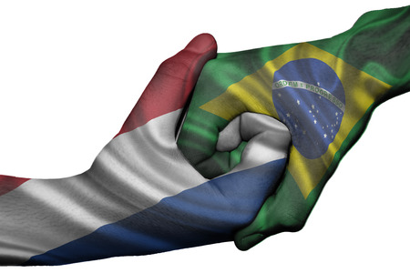 Diplomatic handshake between countries: flags of Netherlands and Brazil overprinted the two hands photo