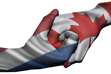 Diplomatic handshake between countries: flags of Netherlands and Canada overprinted the two hands photo