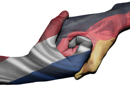 diplomatic: Diplomatic handshake between countries: flags of Netherlands and Germany overprinted the two hands