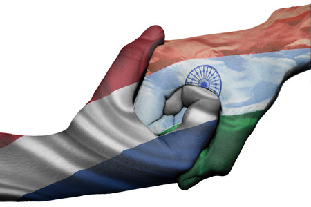 Diplomatic handshake between countries: flags of Netherlands and India overprinted the two hands photo