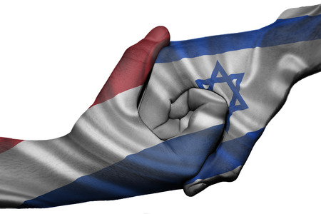 Diplomatic handshake between countries: flags of Netherlands and Israel overprinted the two hands photo