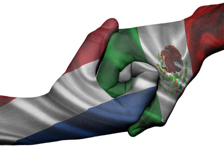 Diplomatic handshake between countries: flags of Netherlands and Mexico overprinted the two hands photo