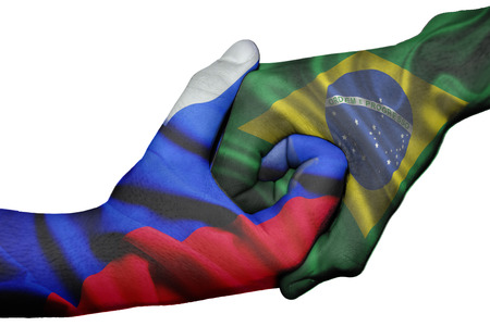 Diplomatic handshake between countries: flags of Russia and Brazil overprinted the two hands photo