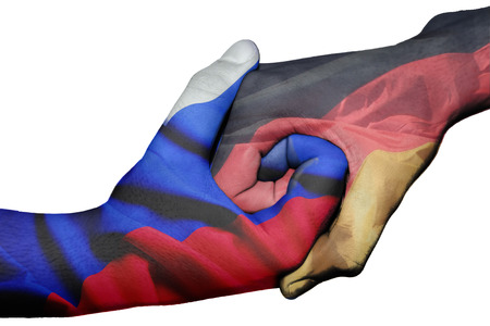 Diplomatic handshake between countries: flags of Russia and Germany overprinted the two hands photo
