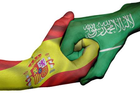 Diplomatic handshake between countries: flags of Spain and Saudi Arabia overprinted the two hands