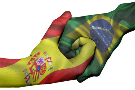 Diplomatic handshake between countries: flags of Spain and Brazil overprinted the two hands photo