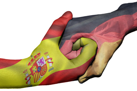 Diplomatic handshake between countries: flags of Spain and Germany overprinted the two hands