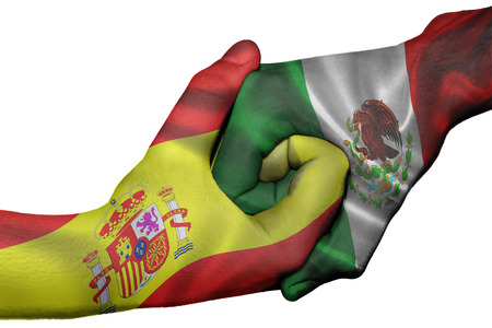 Diplomatic handshake between countries: flags of Spain and Mexico overprinted the two hands