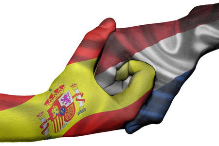 Diplomatic handshake between countries: flags of Spain and Netherlands overprinted the two hands photo