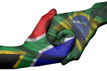 Diplomatic handshake between countries: flags of South Africa and Brazil overprinted the two hands photo